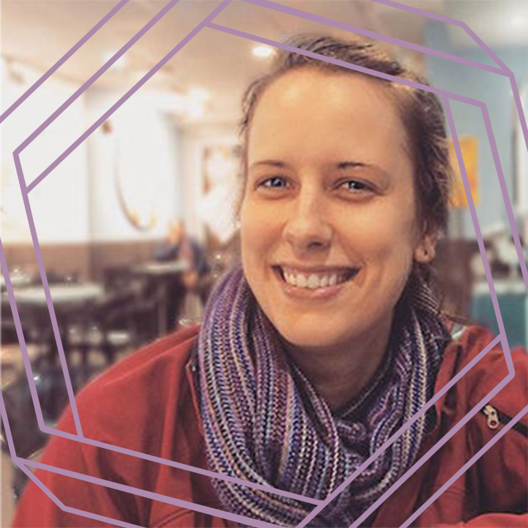 Brianne, a white woman wearing a purple scarf and red jacket, smiles at the camera. There is a stylized purple hexagon superimposed over the photo.