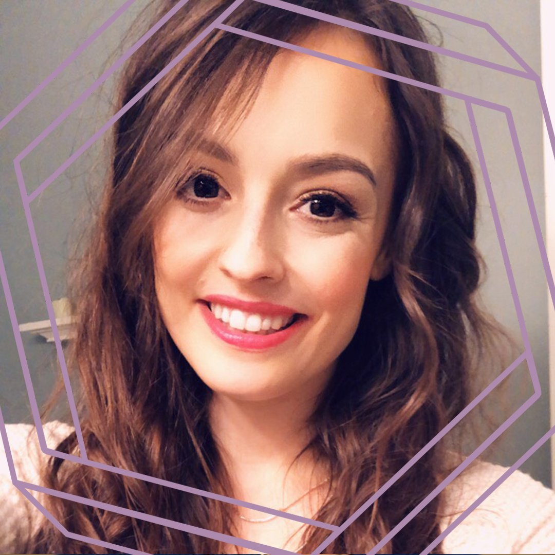 Emily, a white woman with long wavy brown hair, smiles at the camera. There is a stylized purple octagon superimposed around her face.