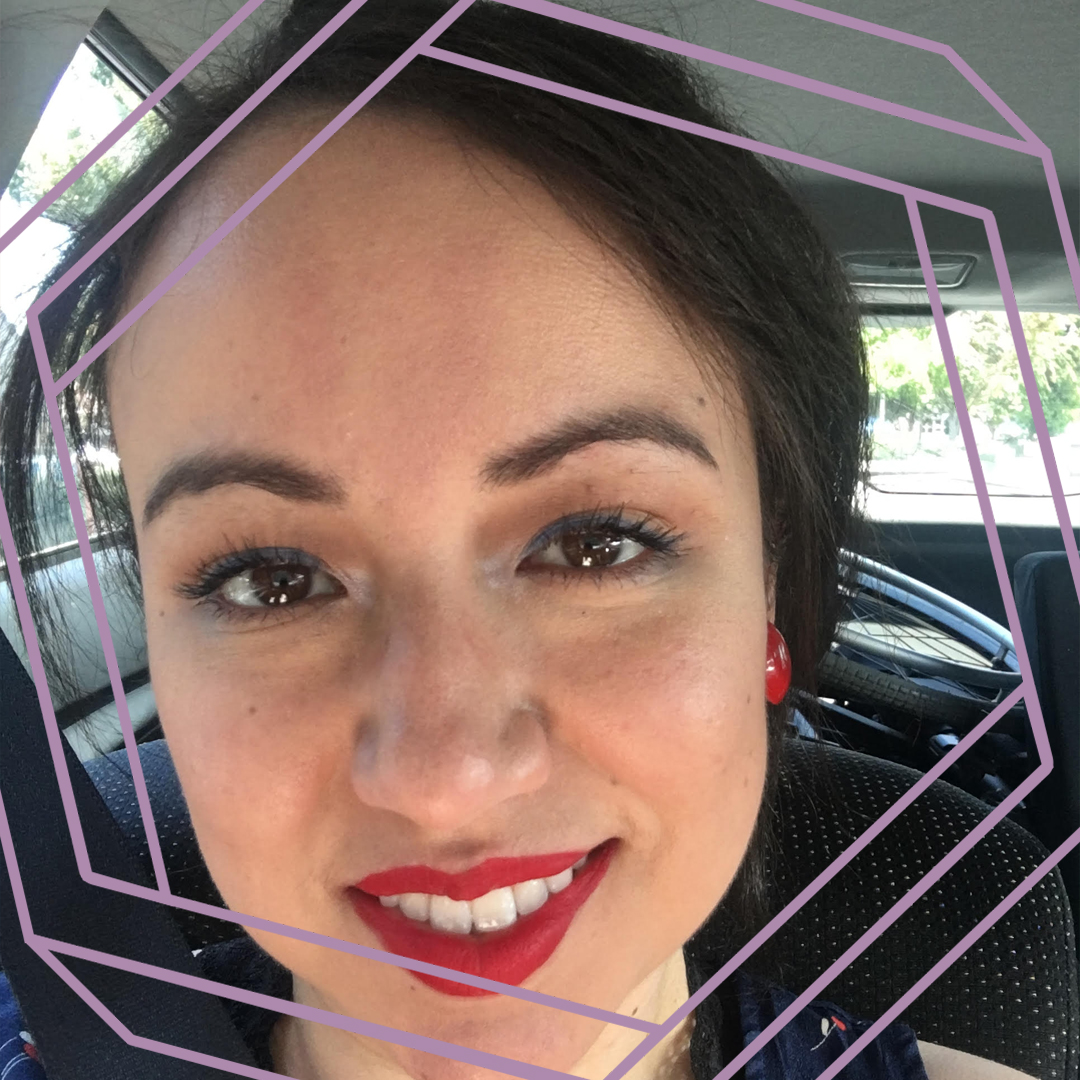 Felisha, wearing red lipstick with her hair tied back in a ponytail, is smiling at the camera. There is a stylized purple hexagon superimposed over the photo.