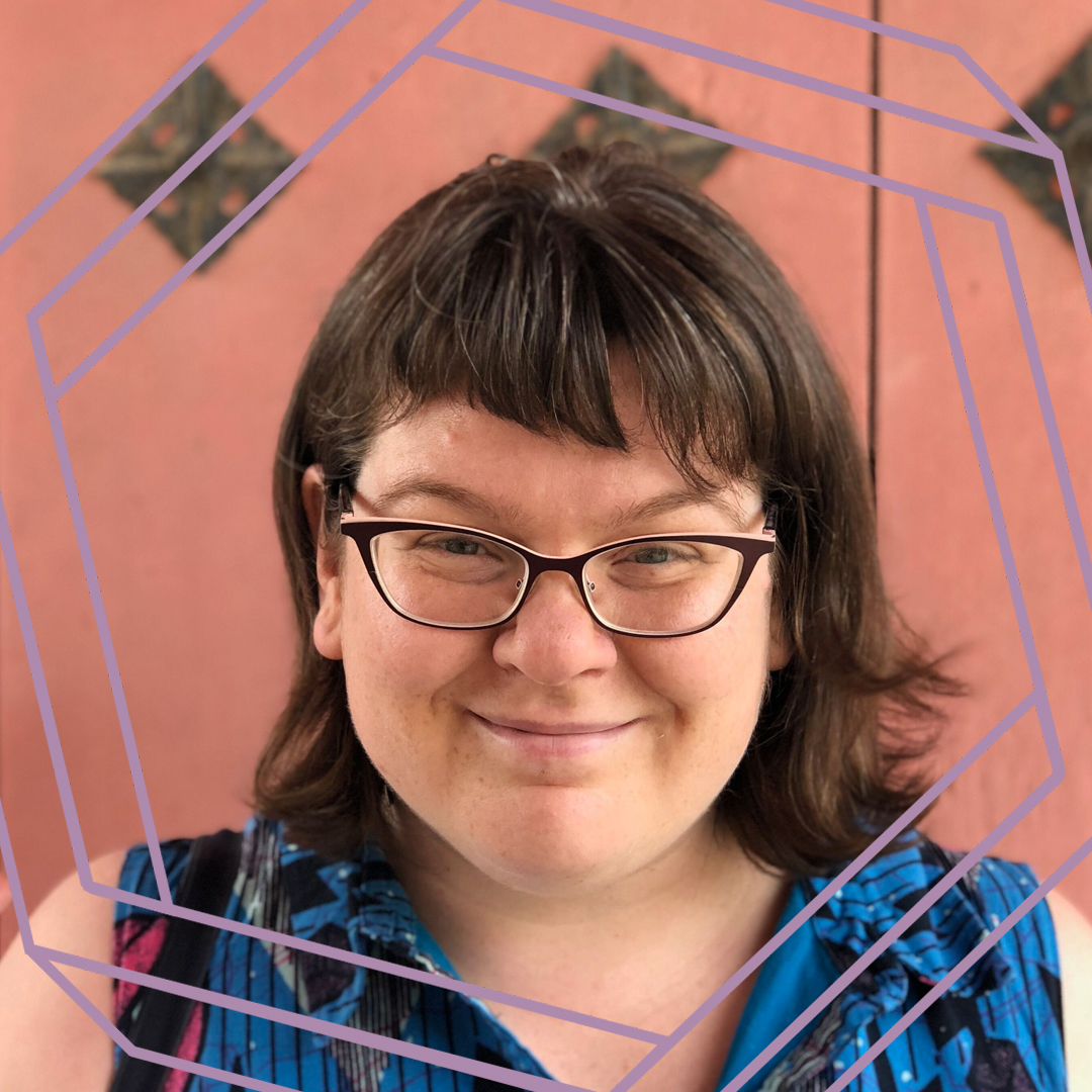 Meredith, a white woman with shoulder-length brown hair and black framed glasses, smiles at the camera. There is a stylized purple octagon superimposed over her face.
