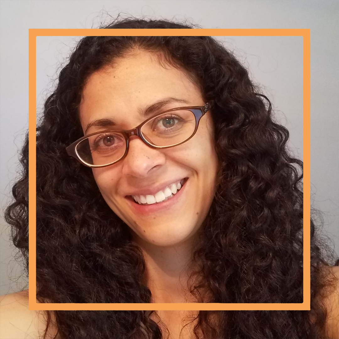 Sara, a woman with long curly brown hair and dark plastic framed glasses, smiles at the camera. There is an orange square superimposed over the photo.