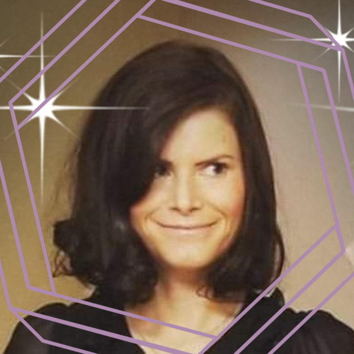 Tina, a white woman with shoulder length brown hair, smiles and looks off camera. There is a stylized purple hexagon framing the photo.